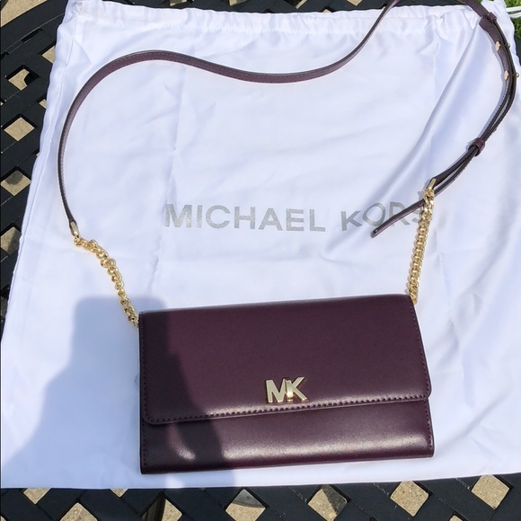 4f4598f08535e4 Michael Kors Damson Mott Leather Clutch. M_5b3117e8c2e9fec2bb30d7fb